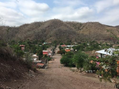 the view of the street where Simon and Mari live
